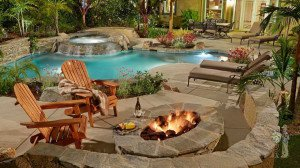 Seating area and firepit over free-form pool