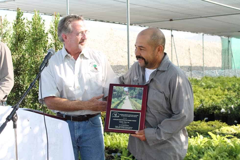 Thomas receiving award for best residential landscape maintenance
