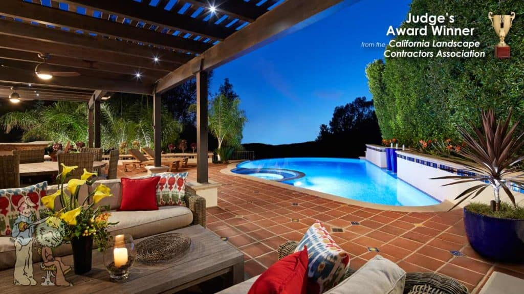 Infinity edge pool with Spanish tile nad custom arbors