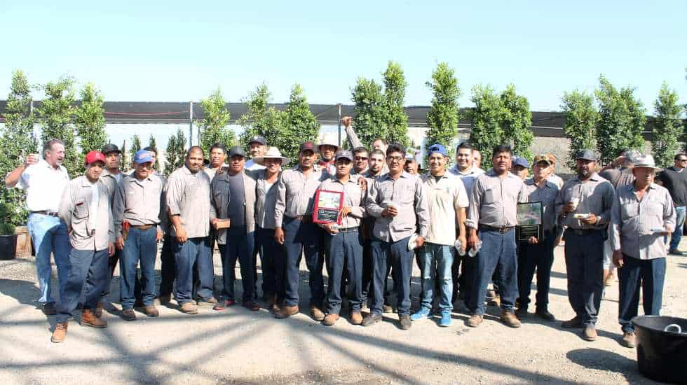 Garden View landscape maintenance crews posing with Awards