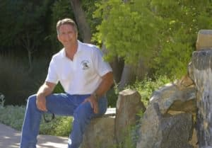 Mark Meahl next to custom pond