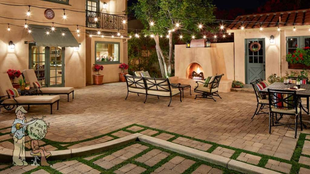 Spanish style backyard fireplace with pavers lights 1024x575