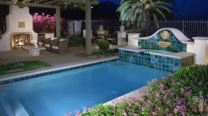 Altadena lap pool and fireplace with water feature