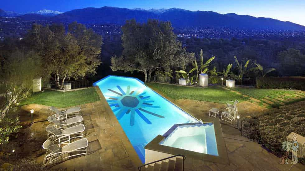 Art Deco style infinity edge pool with custom glass tile mosaic