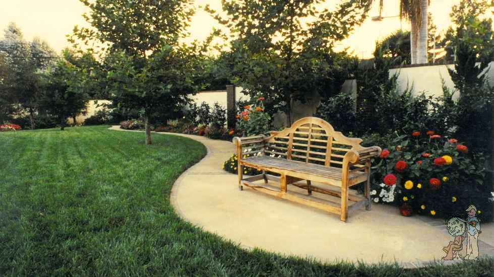 backyard landscape with bench and paths