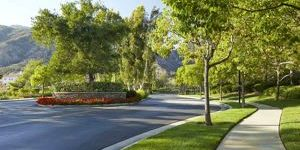 Landscape maintained by garden view entry to Mountain Cove HOA