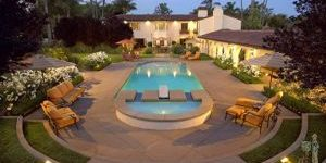 Formal pool and spa with diving board at Spanish style house