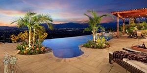 infinity edge pool with concrete and palm trees