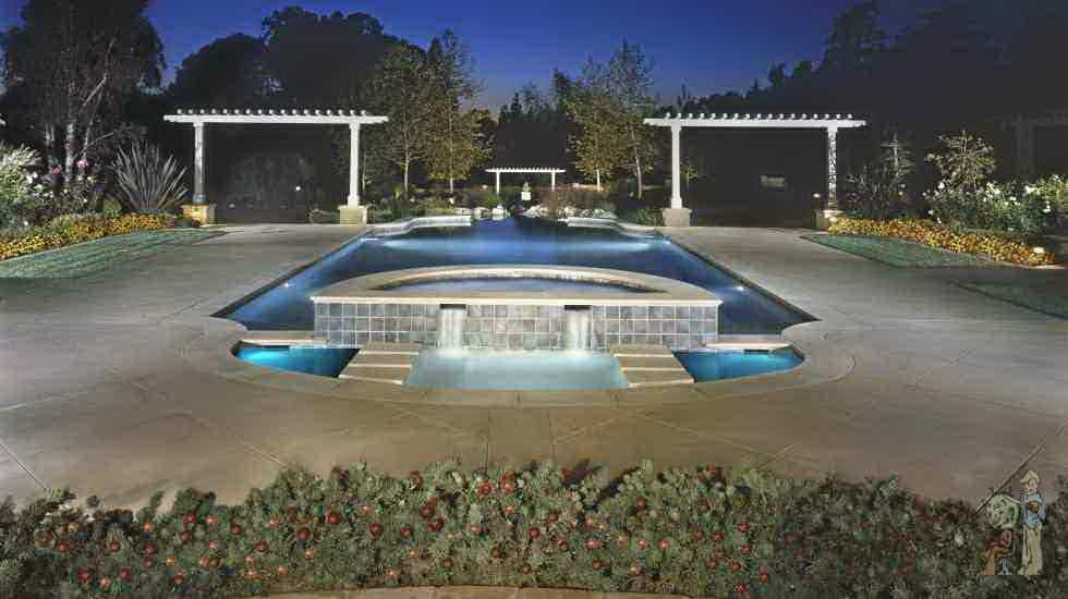 Formal pool with fountain and arbors in Bradbury, California