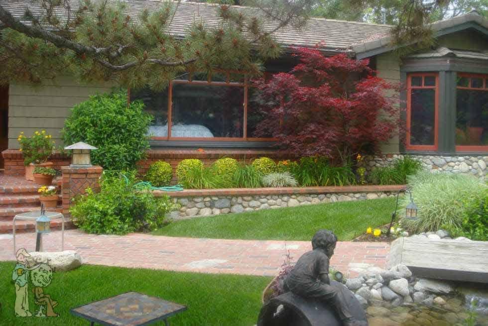 brick pathway to front door with bronze statues in Sierra Madre, California