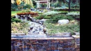 Bridge Over Stream with Ledger Stone Waterfall