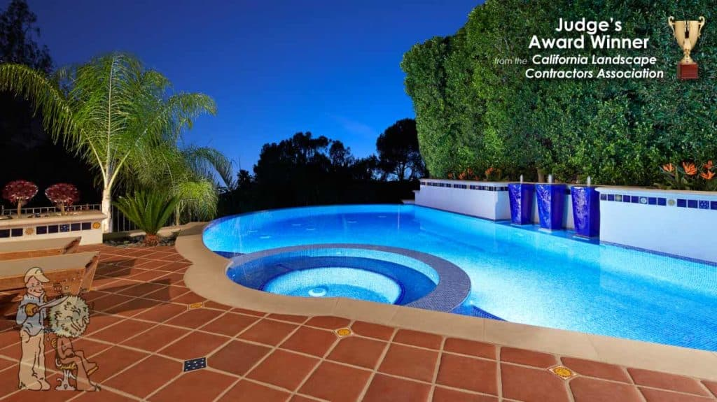 Close up of CLCA award winning infinity edge pool with glass tile and pottery water features