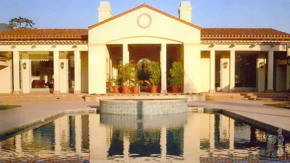 Reflective pool and Spanish style house