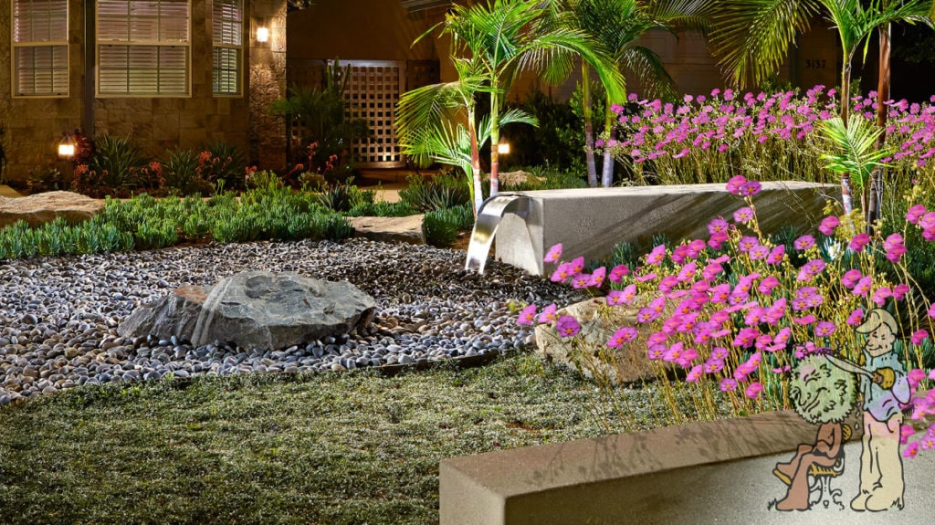 Pondless water feature with boulder and rock bed