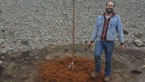 Ian happy after planting the tree