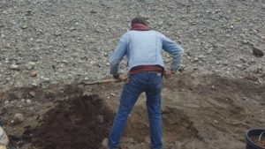 man mixing fertilizer