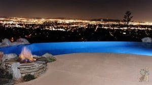 Informal infinity edge pool with firepit