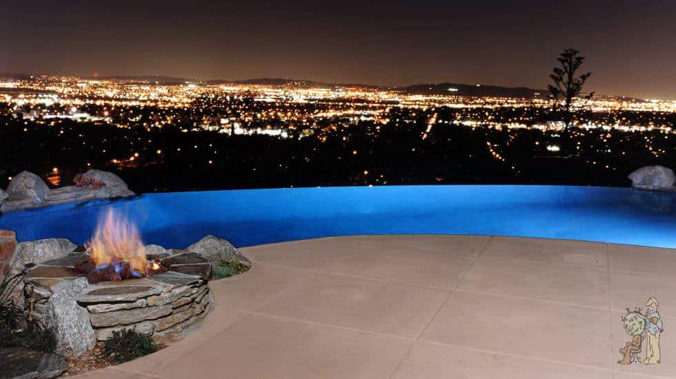 City lights and infinity edge pool