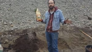 man holding Kelp Meal bag to be mixed into fertilizer