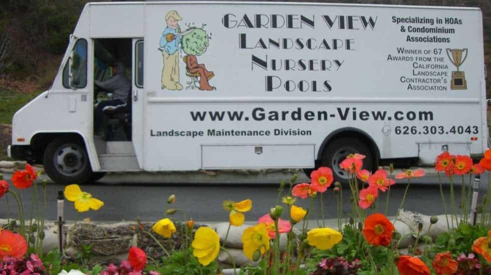 Garden View Landscape Maintenance Truck behind some flowers
