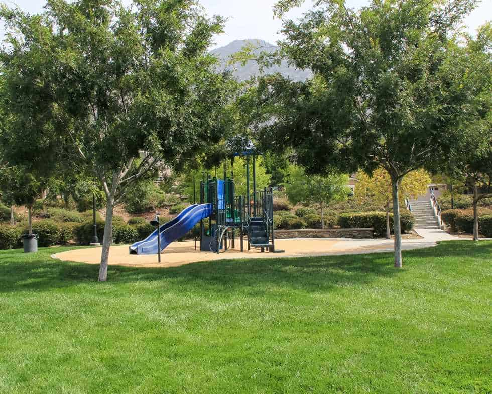 Azusa CA playground with grass and trees maintained by Garden View
