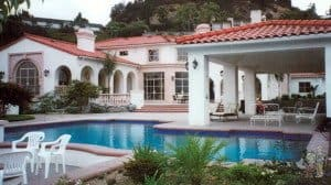 Mediterannean pool with covered patio