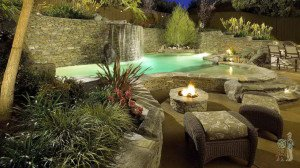 Monrovia stacked stone swimming pool with firepit and seating area