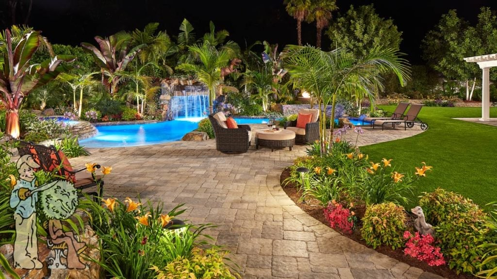 Paver pathway to tropical pool and spa