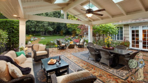 large custom canopy structure with skylights covering firepit and outdoor living room