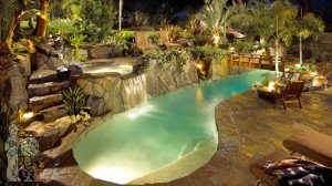 Free Form lap pool with spa and bridge composed with all natural rock and boulders