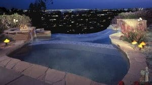 Pasadena infinity edge pool and spa overlooking night San Gabriel Valley's night sky