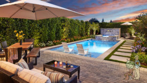 Pool and landscape with pavers, spa and dining area
