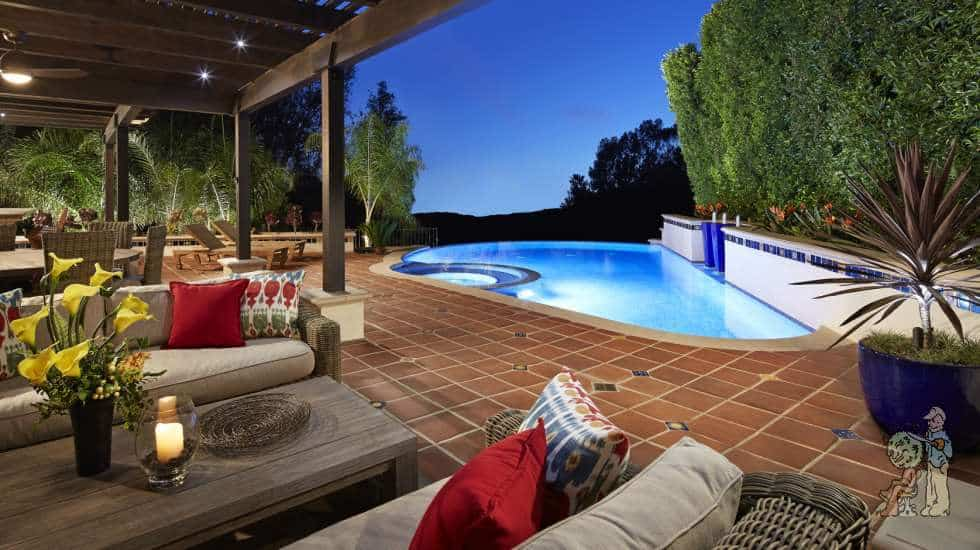 Infinity Edge Pool and Outdoor Living Room with Custom Spanish tile