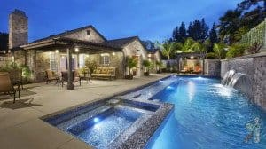 glass tile pool with 3 fountain water feature and spa