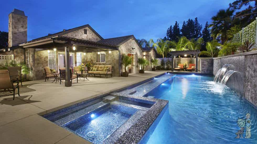 glass tile pool with fountainwaterfeatureandspa