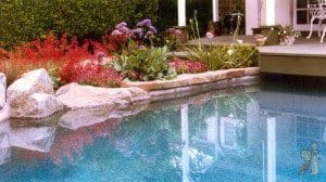 Real boulders built into swimming pool