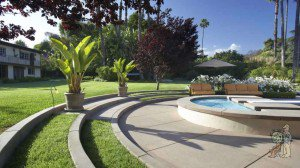 Spa with grass divided curved concrete steps