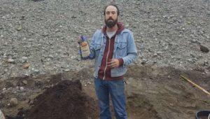 "man holding G&B Organics ""Starter Fertilizer"" to be mixed in"