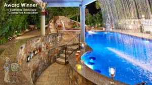 Waterfall and swim-up pool bar