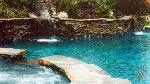 Swimming pool and spa with cascading waterfall