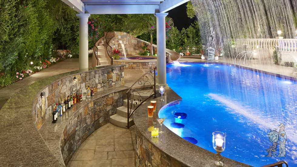 in-pool bar with custom stone and waterfall overhang